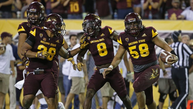 ASU's Salamo Fiso (58) celebrates after intercepting a pass against California during the second half at Sun Devil Stadium on September 24, 2016 in Tempe, Ariz.