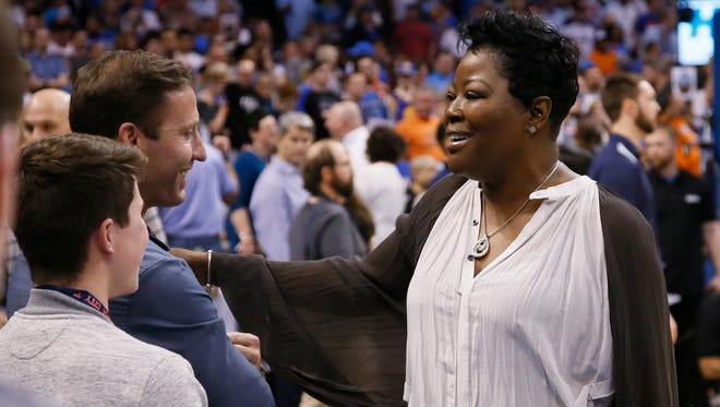 Wanda Durant, the mother of Golden State Warrior's Kevin Durant, talks with fans as she arrives for an NBA basketball game between the Golden State Warriors and the Oklahoma City Thunder in Oklahoma City, Saturday, Feb. 11, 2017.