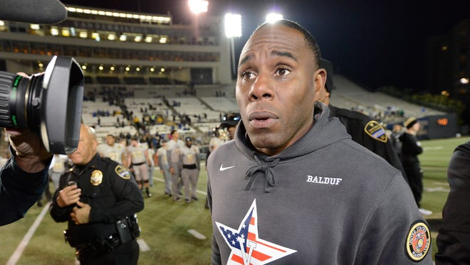 Vanderbilt head coach Derek Mason walks off the field after losing 44 to 21 against Kentucky at Vanderbilt Stadium Saturday, Nov. 11, 2017 in Nashville, Tenn.