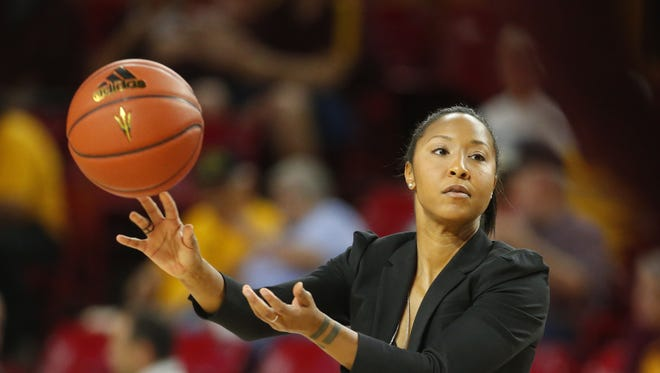 Arizona State Sun Devils assistant coach Briann January helps the team warm up before a women's basketball game against Sacramento State Hornets at Wells Fargo Arena in Tempe on November 18, 2017.