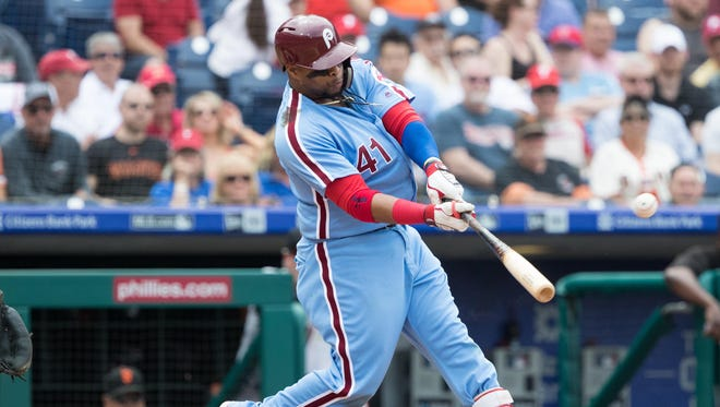 Philadelphia Phillies first baseman Carlos Santana (41) hits a three RBI home run during the fourth inning against the San Francisco Giants at Citizens Bank Park. Mandatory Credit: Bill Streicher-USA TODAY Sports