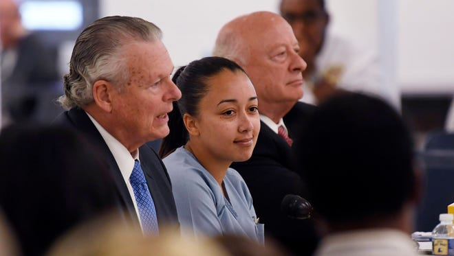 Cyntoia Brown, the Nashville woman sentenced to life in prison at age 16 for the murder of a stranger who picked her up at a fast food restaurant, appears at a clemency hearing Wednesday, May 23, 2018, at Tennessee Prison for Women in Nashville, Tenn. It is her first bid for freedom before a parole board since the 2004 crime.