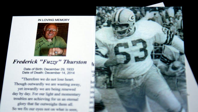 The memorial card for Fuzzy Thurston at Thurston's memorial service at Lambeau Field December 19, 2014.