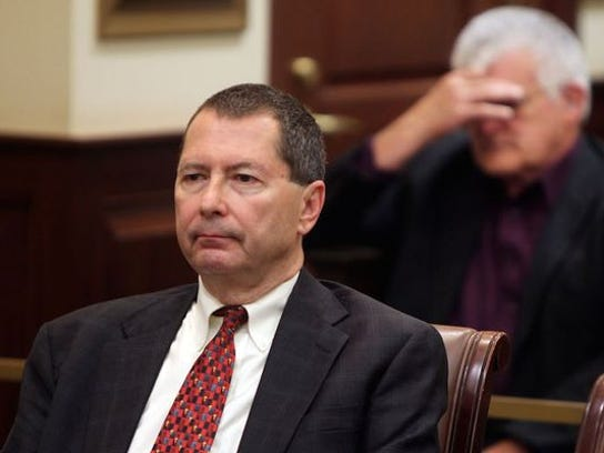 Former state Rep. Pete Beck (left) sits in court while