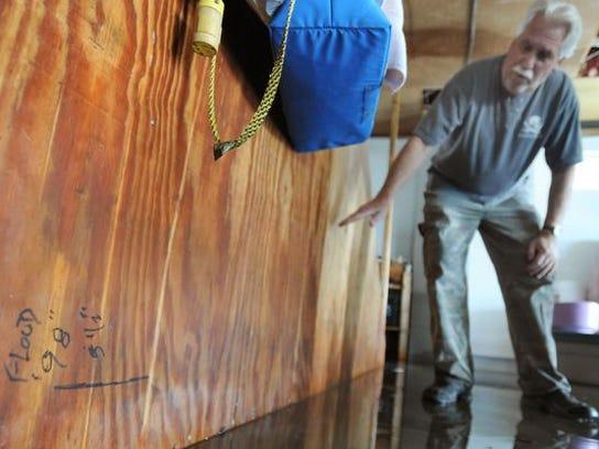 Bob Buckler of Fenwick Island shows where the water