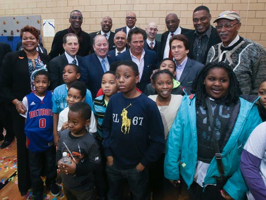 Pistons owner Tom Gores and other invited guestes pose