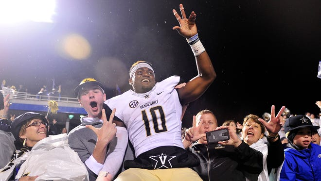Vanderbilt wide receiver Trent Sherfield celebrates a 17-13 win over Middle Tennessee State with fans at Floyd Stadium in Murfreesboro on Oct, 3, 2015,