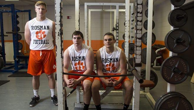 Rosman football players Neil Tesnow, Jonathan Holliday and Tanner Whitman.