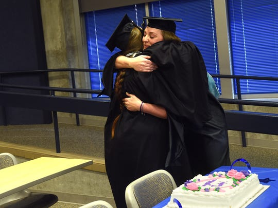 "Kendra Warthan, left, gets a hug from her academic advisor Jenna Dewar at her ""Almost Commencement Ceremony"" in the Jot Travis building at the University of Nevada, Reno on Jan. 31, 2017."