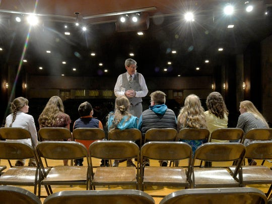 Tim Paul, pronouncer for the 2018 Cascade County Spelling Bee talks to the eight spelling bee finalists on Friday in the West Elementary School auditorium.