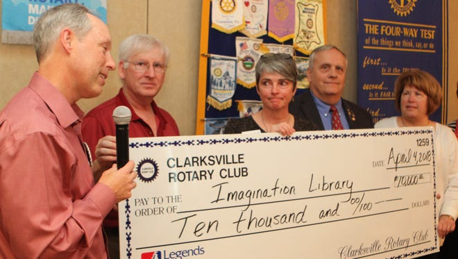 Steve Kemmer, Jim Jay, Gary and Ginny Newman of Clarksville Rotary Clubs present Martha Hendricks, center, a surprise $10,000 donation check for Imagination Library.