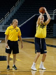 Michigan coach John Beilein talks to Moritz Wagner as he works on his shooting touch during practice on Thursday.