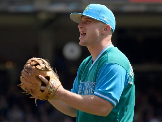 Seattle Mariners third baseman Kyle Seager reacts after