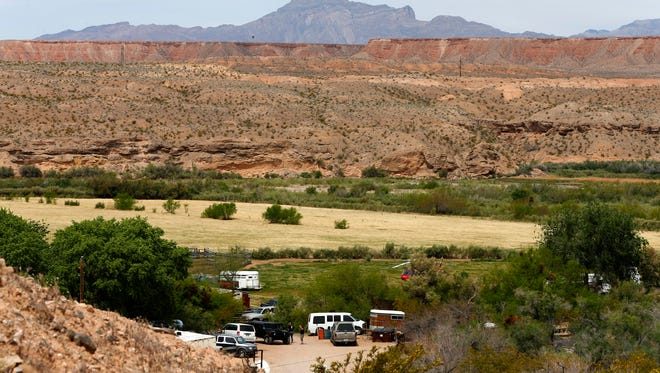 Armed security guards keep watch over the entrance to Rancher Cliven Bundy house on April 11 west of Mesquite, Nev.