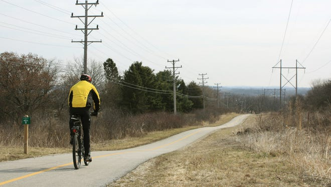 A bicyclist rides the Lake Country Recreation Trail in Waukesha County.
