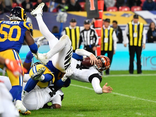 Oct 27, 2019; London, United Kingdom; Los Angeles Rams defensive tackle Aaron Donald (99) sacks Cincinnati Bengals quarterback Andy Dalton (14) during the third quarter of the game between the Los Angeles Rams and the Cincinnati Bengals during an NFL International Series game at Wembley Stadium. Mandatory Credit: Steve Flynn-USA TODAY Sports