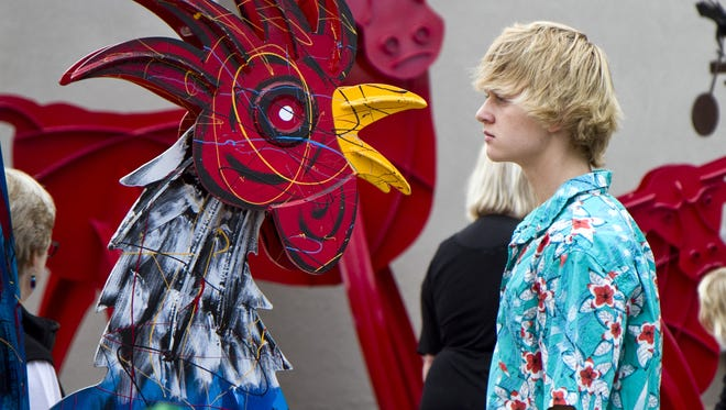 Cameron Duddley of Gilbert, looks at one of the Prescott Kinetic Sculptures during the 2012 ArtFest of Scottsdale.