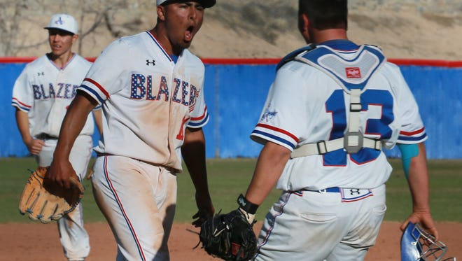Americas' pitcher Nick Carrillo, left, and catcher Bobby Galindo celebrate the Trailblazers' victory over Faith Christian in the SISD Tournament championship game Saturday.