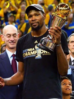 Kevin Durant celebrates after winning NBA Finals MVP.