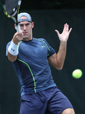 Robby Ginepri returns the ball against Joel Kielbowicz during the Pearson Ford Open tennis tournament at Woodstock Club, Sunday, June 21, 2015.  Ginepri won the match in two sets.