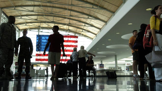 Silhouetted passengers waiting for their baggage at the baggage claim area at the Shreveport Regional Airport. More flight options are expected to be available as early as 2017.