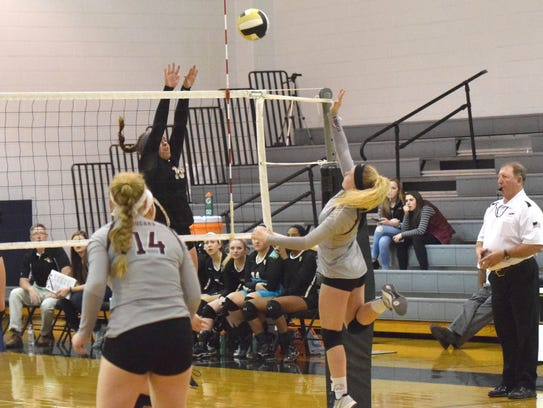 Stuarts Draft's Kenna Swink, right, sends the ball
