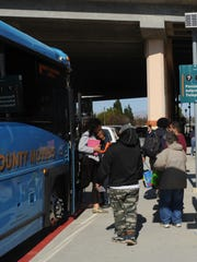 People wait for trains and buses at the Camarillo Transit Center. Fewer people are riding buses in Ventura County, a study shows.