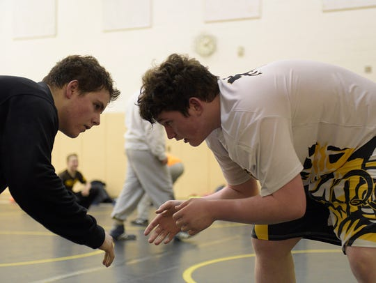Zach Doran (right) practices with a teammate in preparation