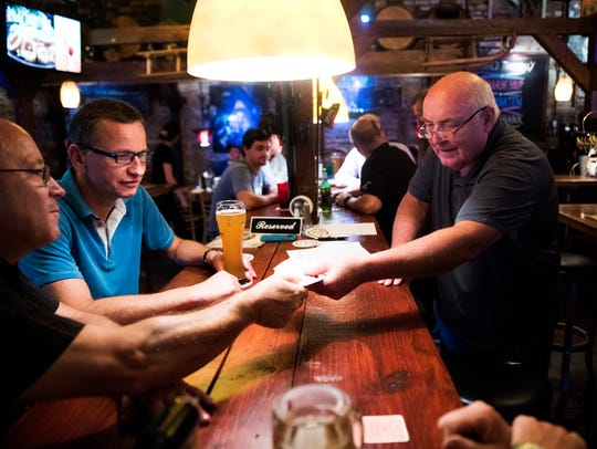 This 2017 file photo shows a group of friends playing cards at the Hans & Franz Biergarten off State 14 in Greenville County's east side. The beer garden's restaurant is inside one of the county's oldest buildings, the former Pelham Mills store, near Rocky Creek and Ebenezer Road.