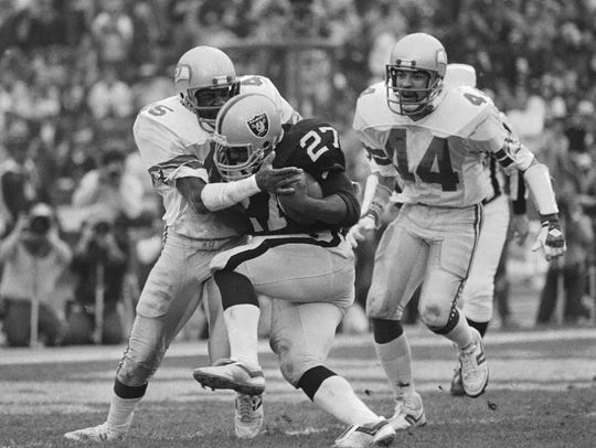 Seahawks safety Kenny Easley tackled Raiders running