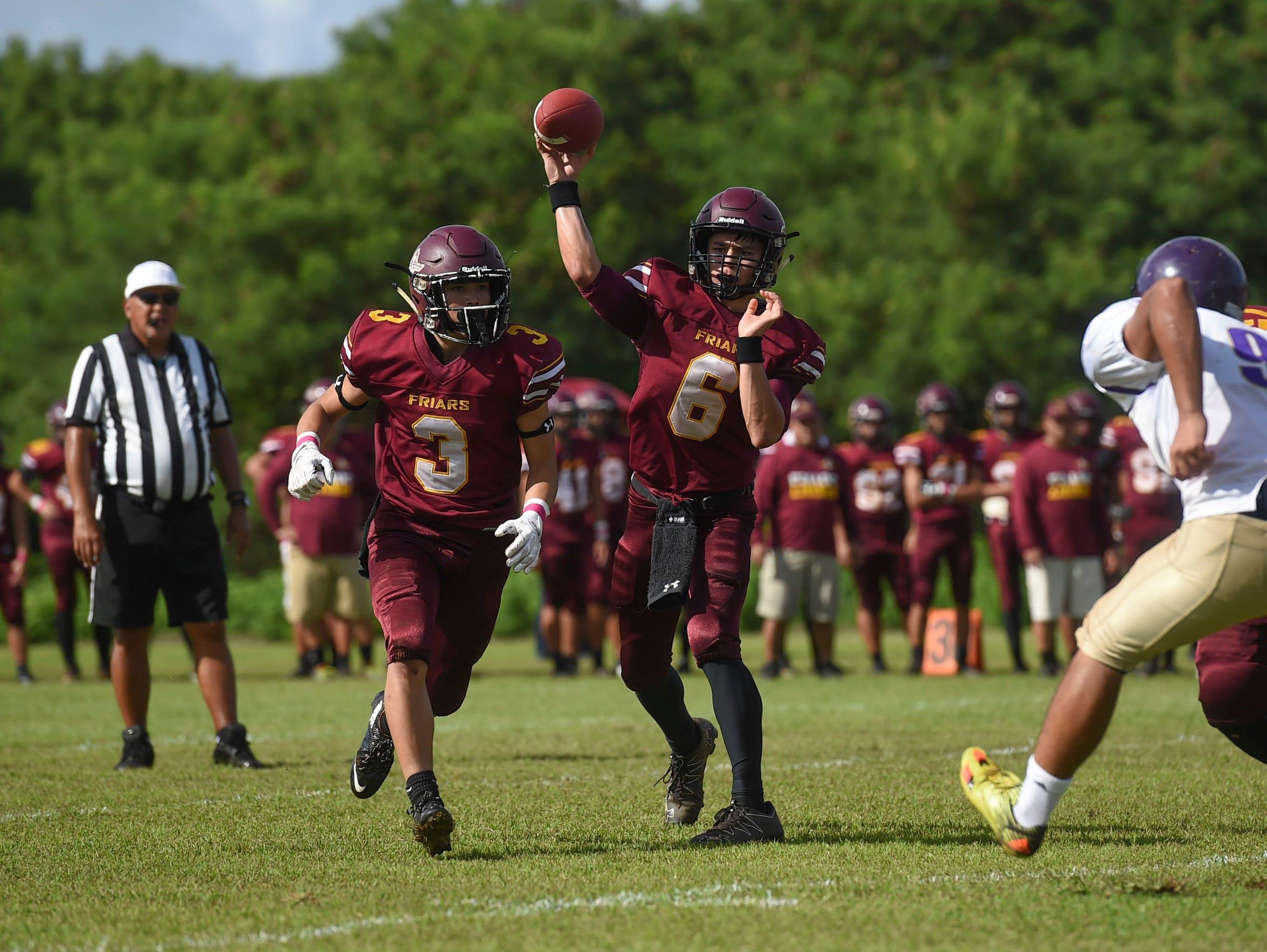 Father Duenas quarterback Daniel Phillips (6) makes