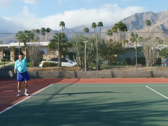 Vic Adams serves to friend Norm King during one of their regular tennis matches, February 22, 2018.  The two have been playing tennis together regularly in Palm Springs for the past 29 years.