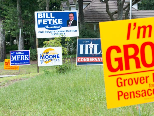 Political lawn signs in Pensacola on Tuesday, July17,