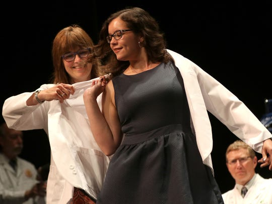 Patricia Toro-Perez is coated during the Medical College of Wisconsin Central Wisconsin White Coat Ceremony at UW Marathon County, in Wausau, Wisconsin, July 7, 2016.