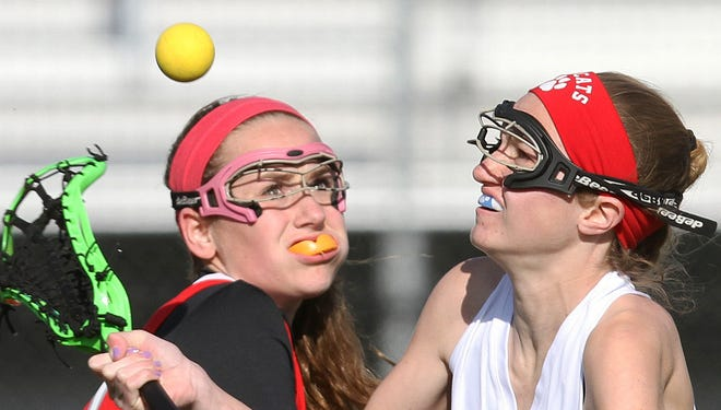 From left, Tappan Zee's Carmella Liscio (19) and Byram Hill's Noelle Love (13) battle for ball control during a girls lacrosse game at Byram Hills High School in Armonk April 9, 2014. Byram Hills won the game 17-12.