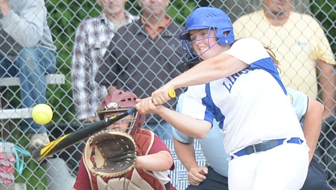 Lincoln's Kerrigan Neff connects with a pitch for the first of her two home runs during Tuesday's Class 2A regional game vs. Scecina.