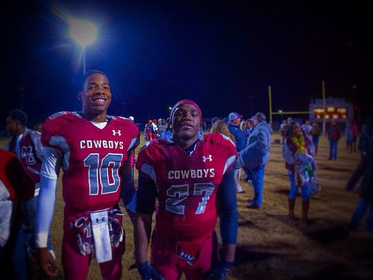 Madison County quarterback Akevious Williams and running back Eric Bright.