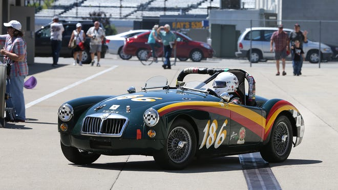 Vintage race cars in the garage and Gasoline Alley during practice Friday, June 6, 2014, afternoon during the The Brickyard Vintage Racing Invitational. Here is a1959 MG driven by Lou Marchant.
