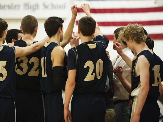 Essex huddles together during the boys basketball game