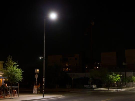 An LED street light illuminates the 100 block of E.