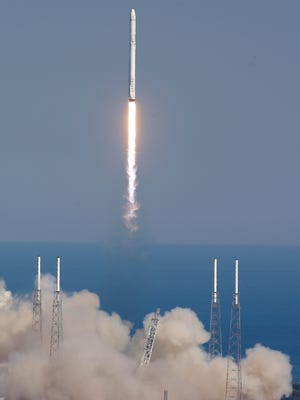 The SpaceX Falcon 9 rocket lifts off from Kennedy Space Center in Cape Canaveral, Fla., on Friday. The rocket will deliver almost 7,000 pounds of science research, crew supplies, and hardware to the International Space Station.