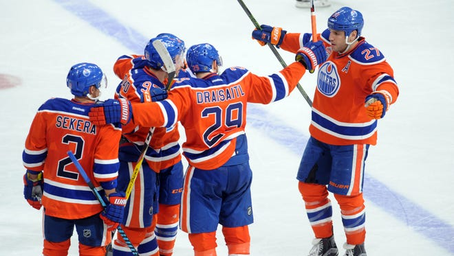 Nov 27, 2016; Edmonton, Alberta, CAN; Oilers players celebrate their goal  against the Coyotes during the third period at Rogers Place. Coyotes won the game 2-1.