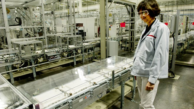 Julie Corcoran with Nissan watches battery parts move down an assembly line at the plant in Smyrna where lithium-ion batteries are made for the Nissan Leaf on Jan. 10, 2013.