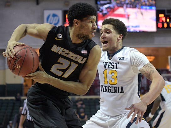 Missouri forward Jordan Barnett (21) fights for position in front of West Virginia forward Teddy Allen (13) during the first half of an NCAA college basketball championship game at the AdvoCare Invitational tournament Sunday, Nov. 26, 2017, in Lake Buena Vista, Fla. (AP Photo/Phelan M. Ebenhack)
