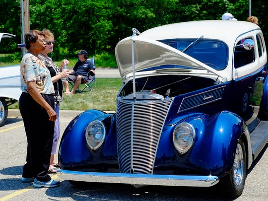 Two women check out this highly customized 1937 Ford at the Father's Day car show Sunday at Mount Hope Church.