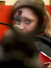 Taylor Gibson, an eighth grader who competes with North Salem's JROTC precision team, has quickly become one of the top shooters in the nation and placed second at a recent national championships. Photo taken in Salem on Tuesday, April 14, 2015.