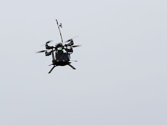 A drone carrying a payload of chemical, biological, radiological and nuclear sensors flies back to its controllers during a technology demonstration at Ft. Leonard Wood on Wednesday, April 11, 2018.