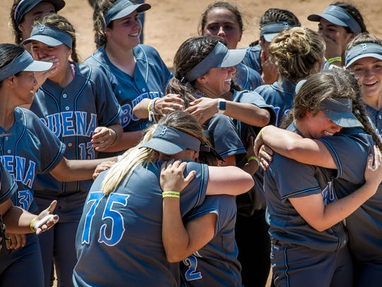 Buena High softball players celebrate after beating San Marcos 5-0 in the CIF-Southern Section Division 4 softball championship last year. The Bulldogs became the first Ventura County softball team to go unbeaten, finishing with a 27-0-1 record.