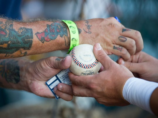 Roger Woodford, of Corydon, Ky., (left) has a baseball autographed by Evansville second baseman Josh Allen during game five of the 2016 Frontier League Championship Series at Bosse Field in Evansville, Monday, Sept. 19, 2016.