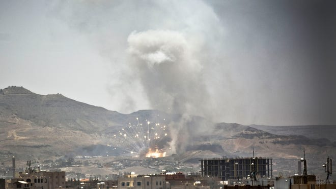 Smoke rises after a Saudi-led airstrike hit a site many believe is the largest weapons cache in Yemen's capital, Sanaa, on April 21, 2015.